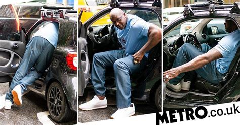 Shaquille O'Neal getting his giant frame into a Smart car