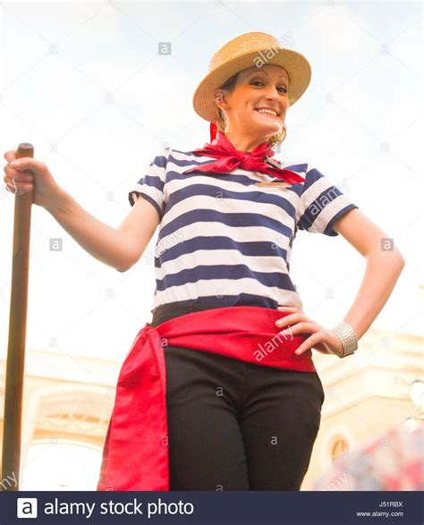 Female gondolier in traditional dress, The Grand Canal